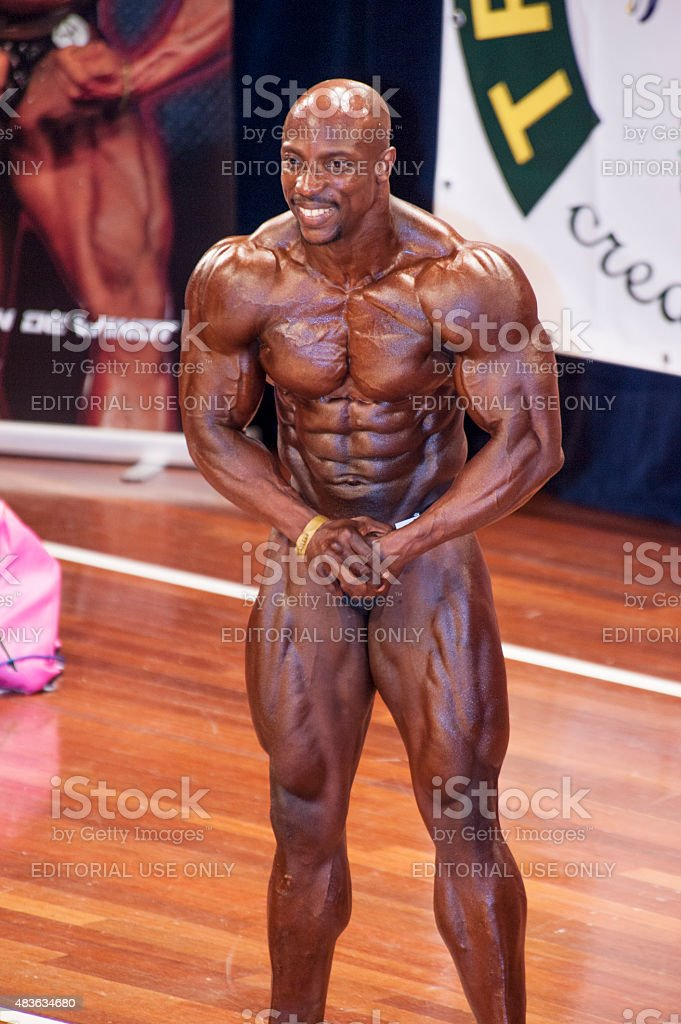 Male bodybuilder showing his best chest pose stock photo
