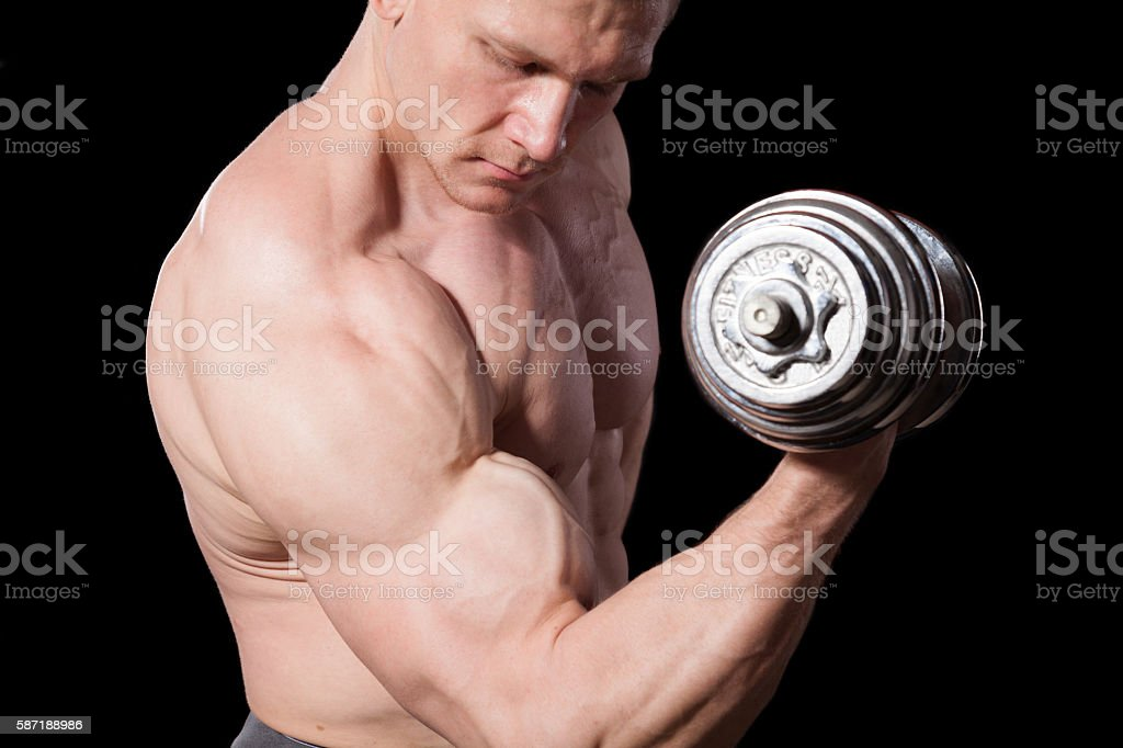 male bodybuilder with dumbbells stock photo