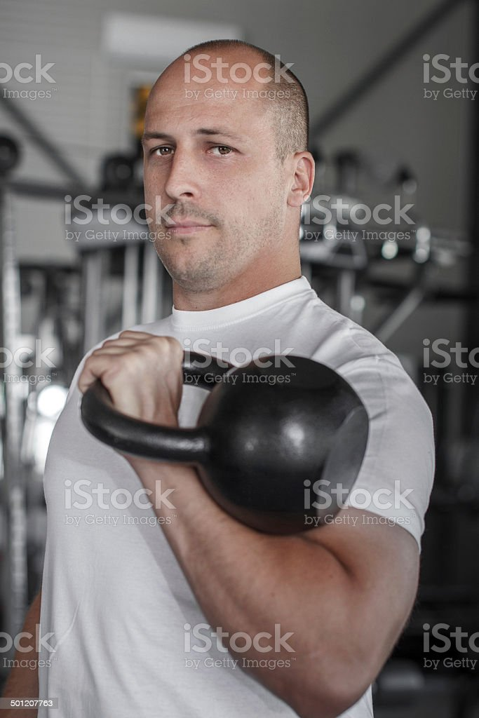 Male bodybuilder with kettlebell royalty-free stock photo