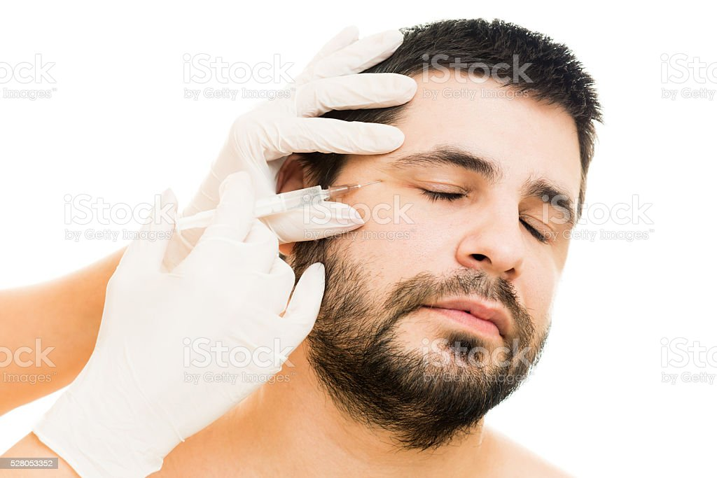 Male botox injection stock photo