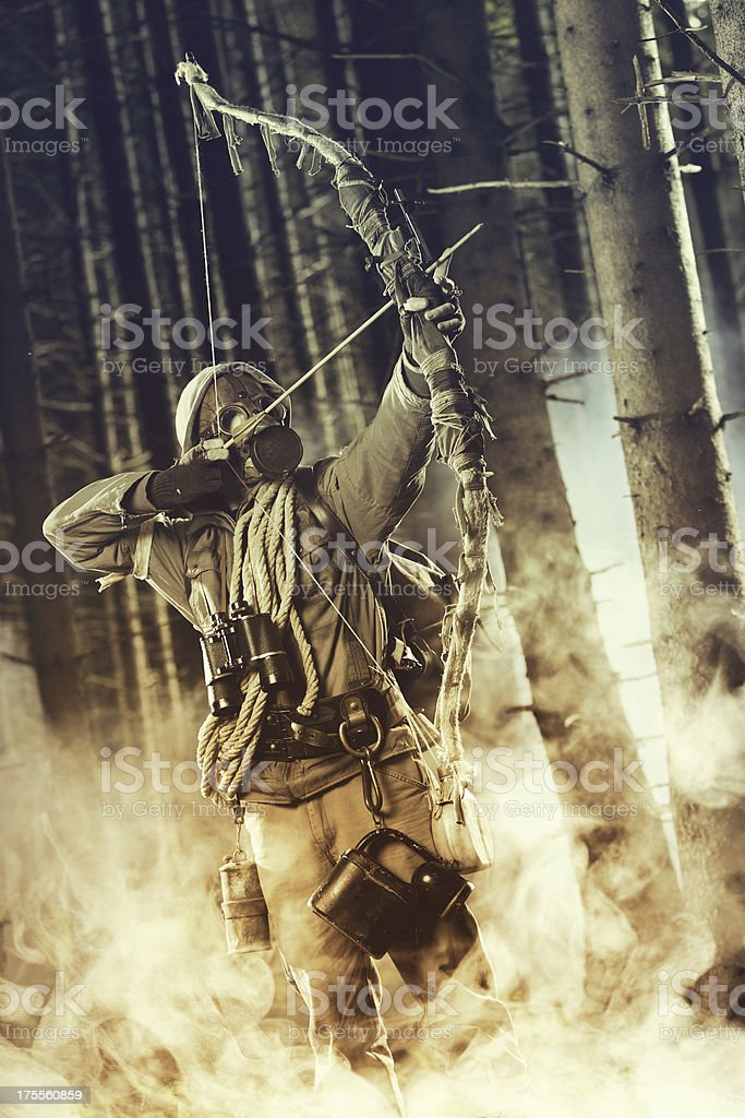 Male bow hunter wearing gas mask royalty-free stock photo