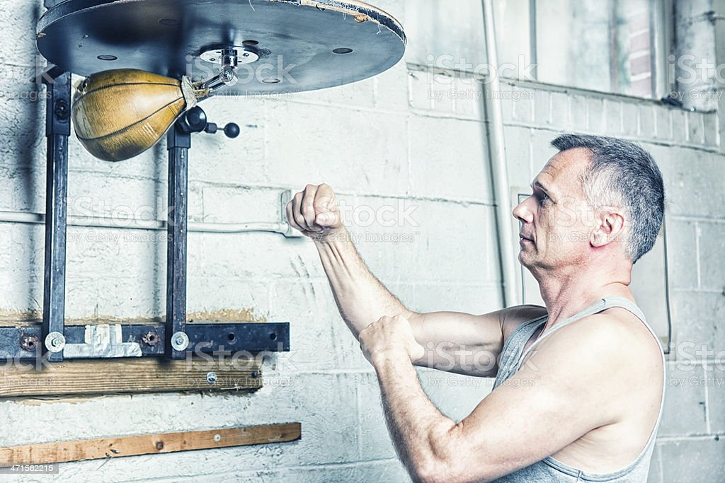 Male Boxer Using Speed Bag stock photo