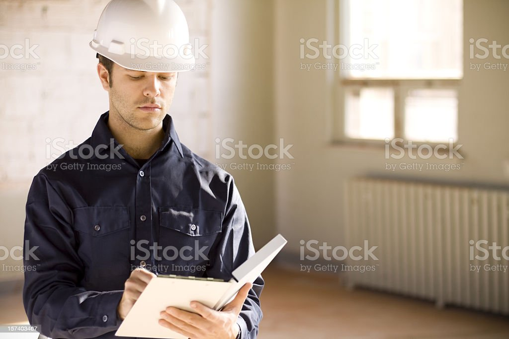 Male building inspector with clipboard stock photo