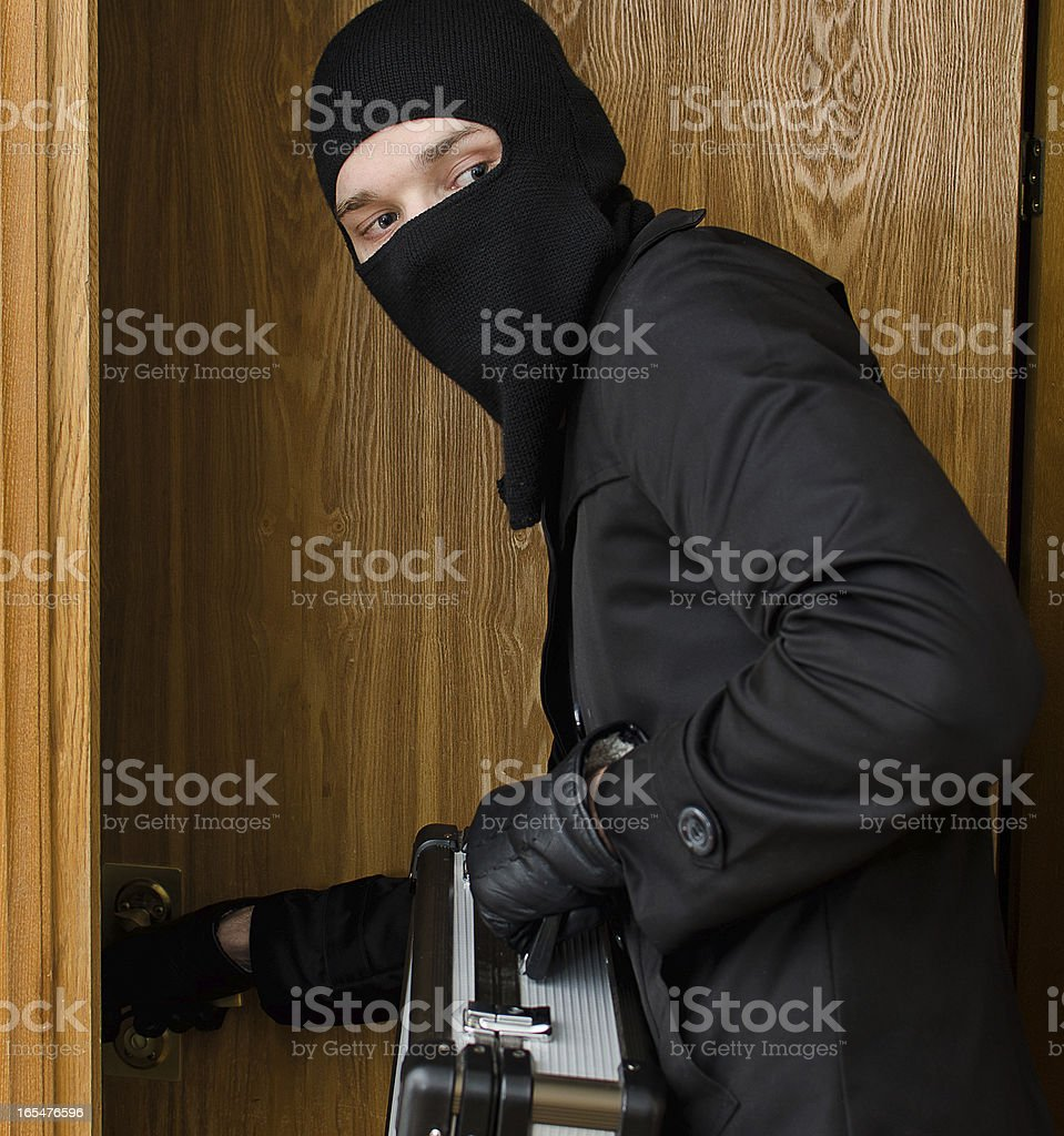 Male burglar stealing case with money royalty-free stock photo
