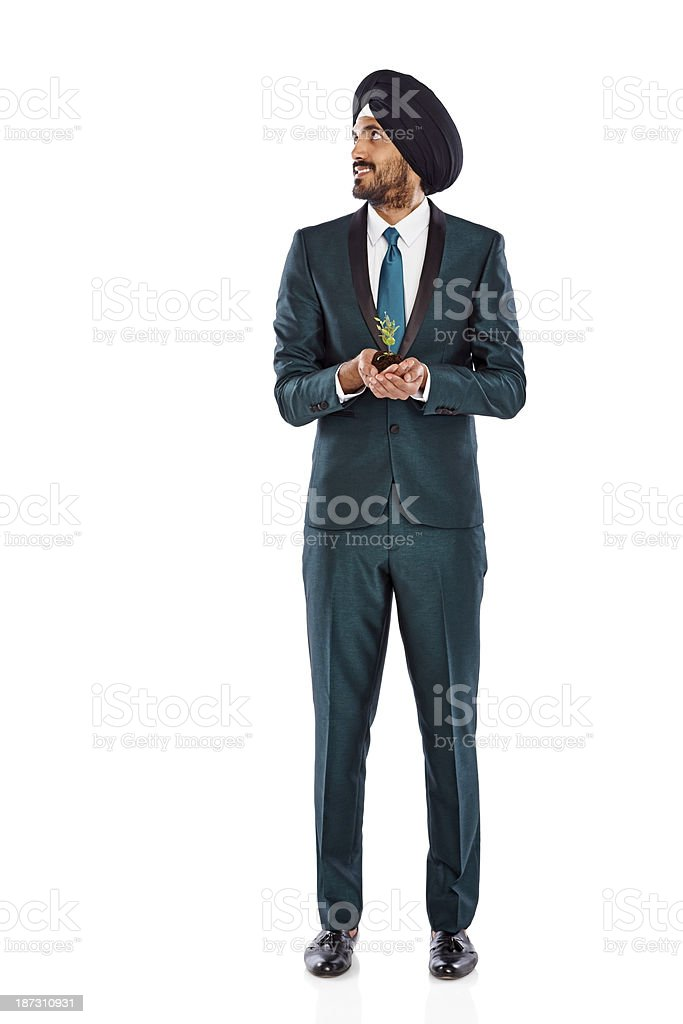 Male business executive with a small plant looking at copyspace royalty-free stock photo