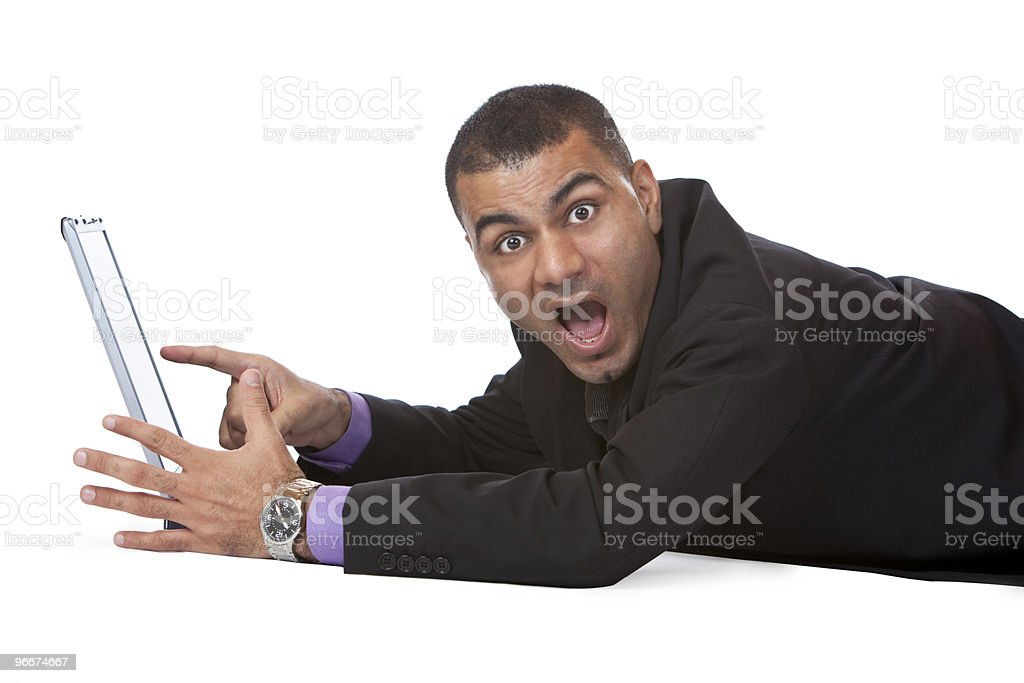 Male business man lying on floor pointing surprised at monitor royalty-free stock photo