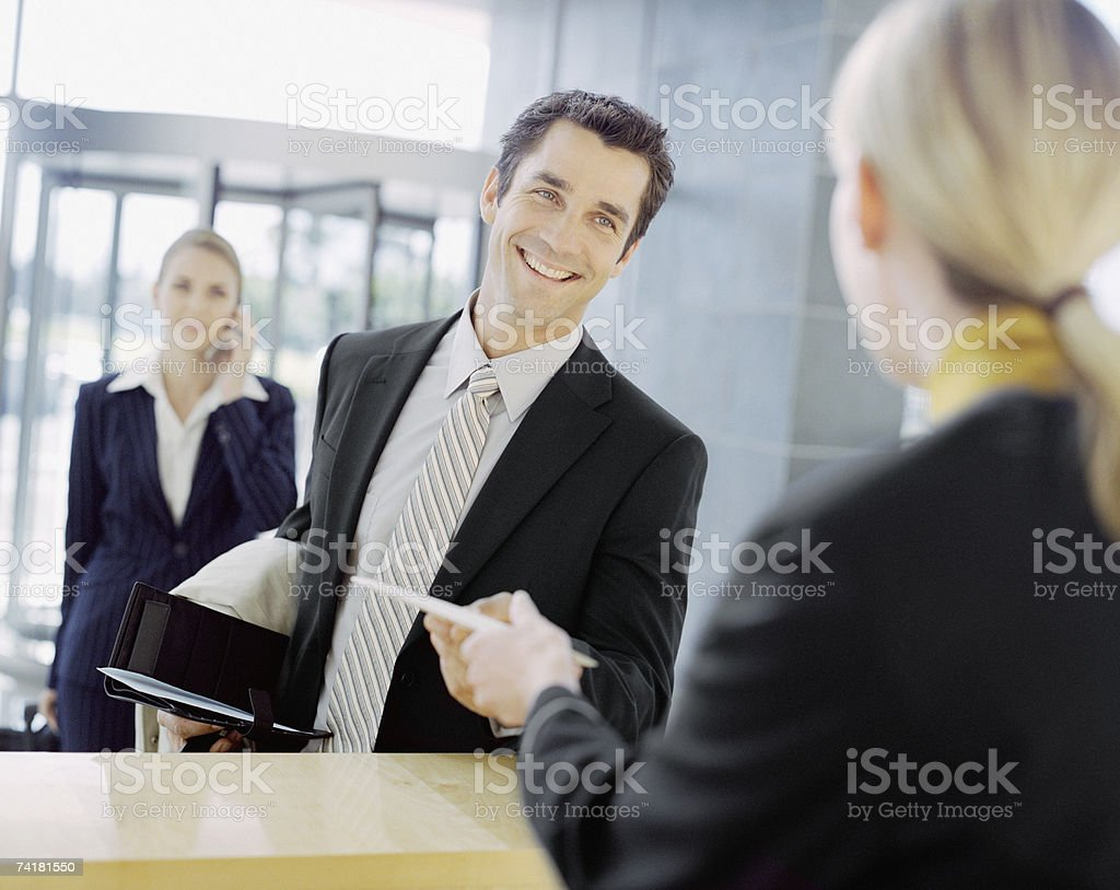 Male business traveler at check in area royalty-free stock photo