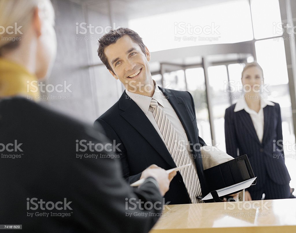 Male business traveler at check in stock photo