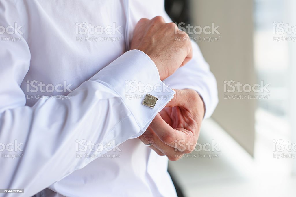 Male buttons cufflinks stock photo