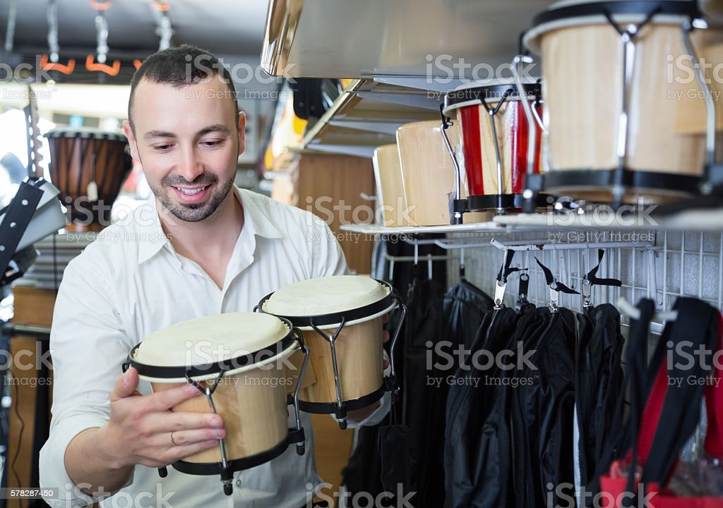 Male buyer choosing drums and accessories stock photo