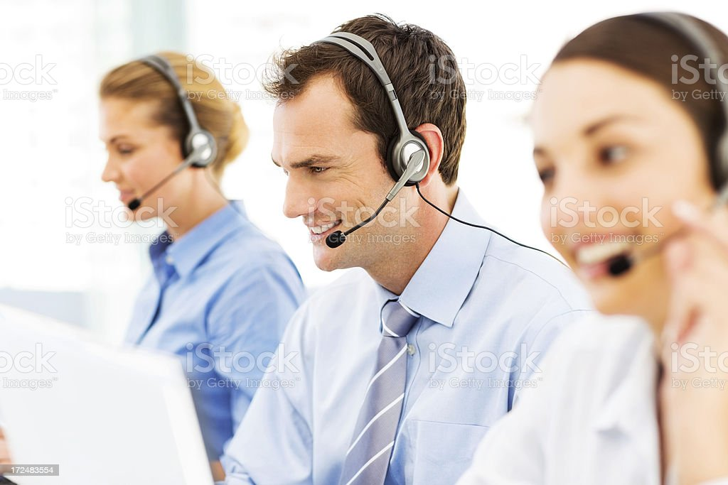 Male Call Centre Representative Amidst Colleagues royalty-free stock photo