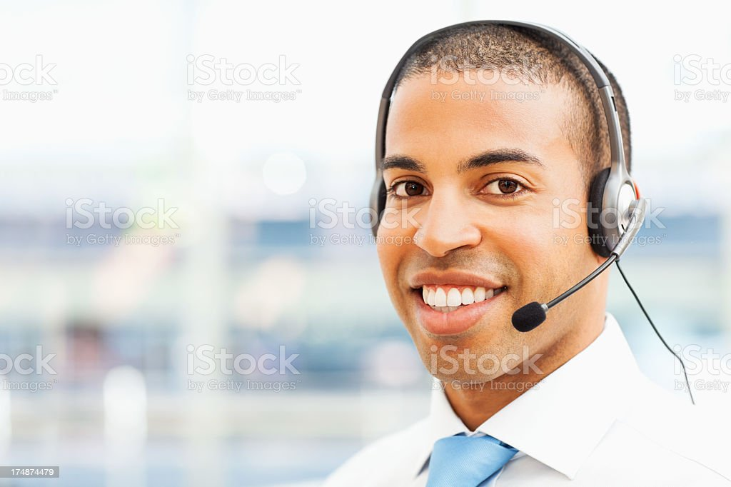 Male Call Centre Representative Wearing Headset royalty-free stock photo