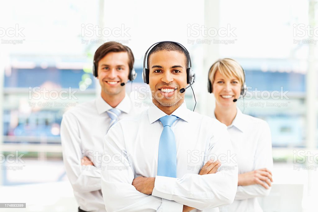 Male Call Centre Representative With Colleagues royalty-free stock photo