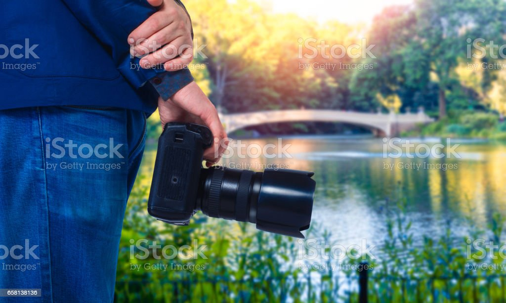 Male cameraman hands with digital camera stock photo