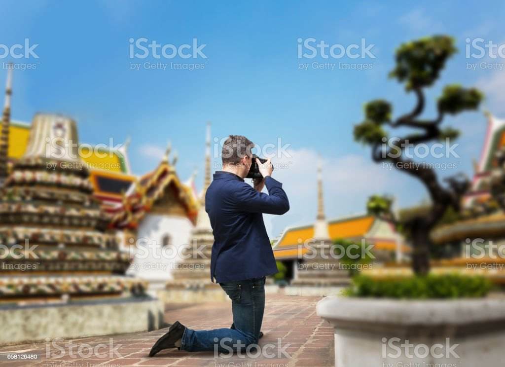 Male camerist taking picture of the temple stock photo
