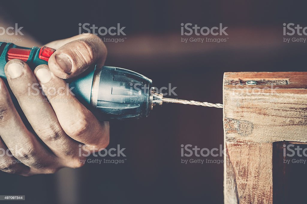 male carpenter at work stock photo