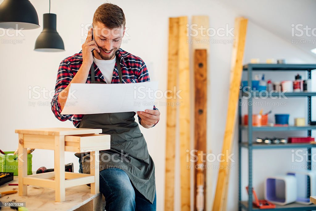 Male carpenter in his workshop stock photo