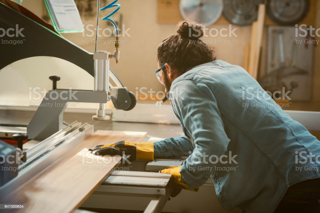 Male Carpenter Working In His Workshop stock photo