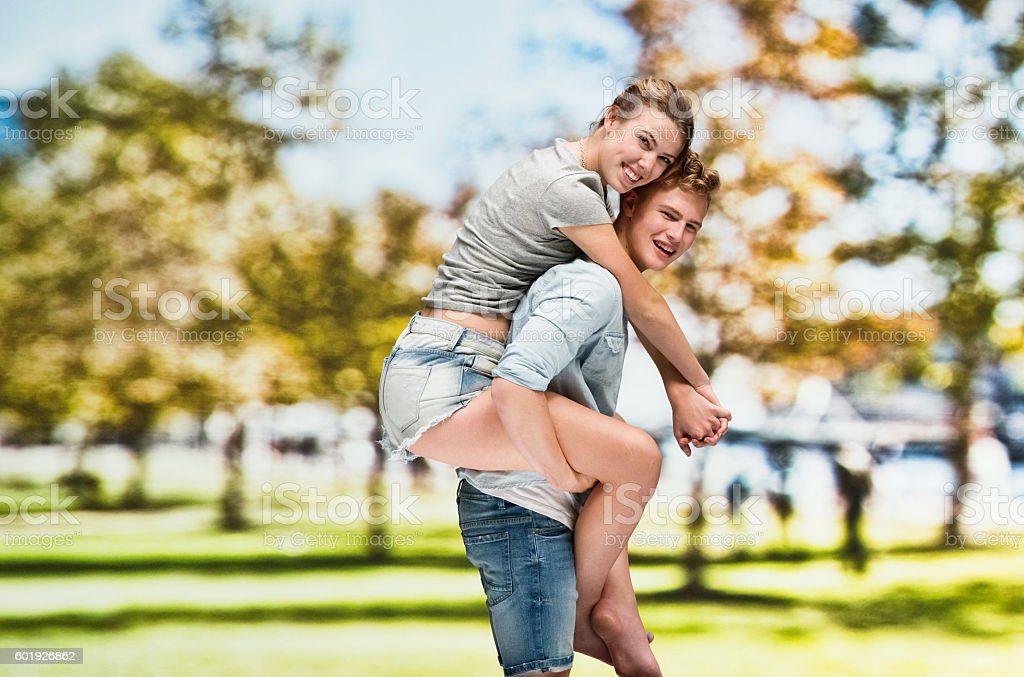 Male carrying female outdoors stock photo
