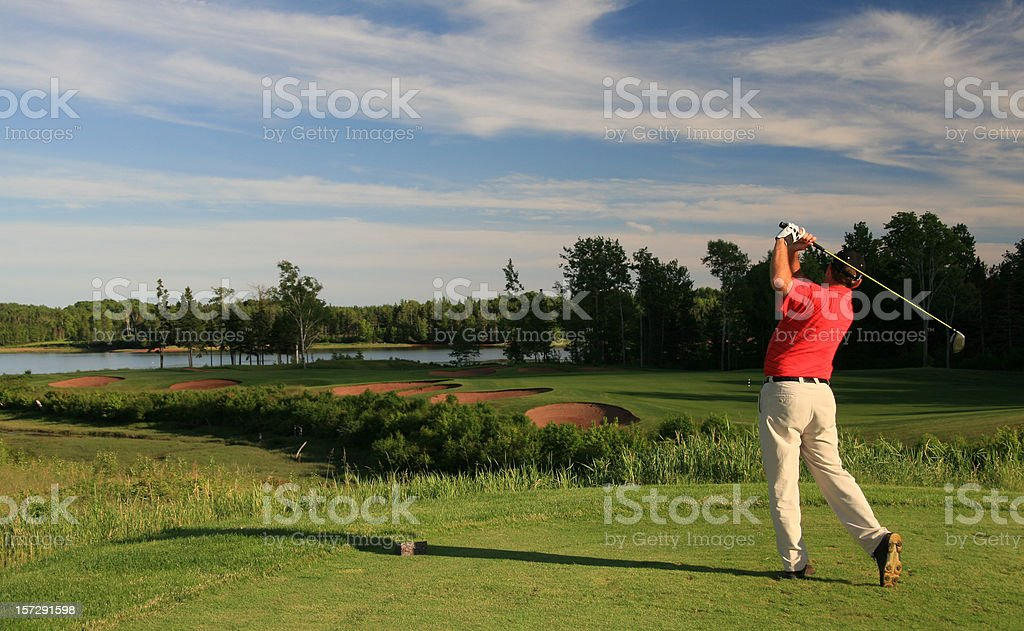 Male Caucasian Golfer in Red Golf Shirt stock photo