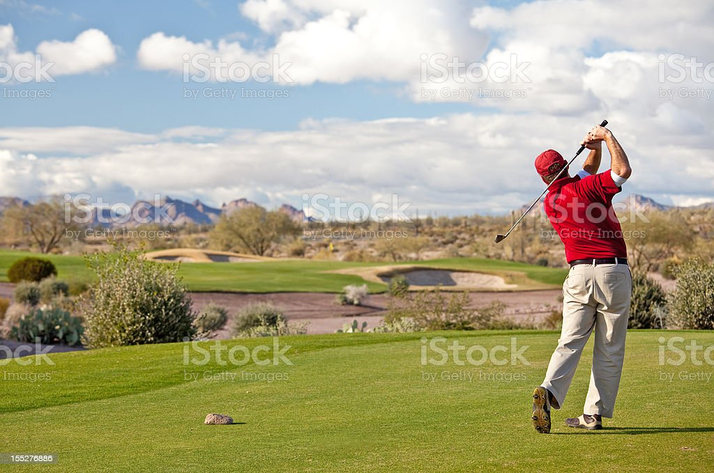 Male Caucasian Golfer on the Tee Desert Golf Course royalty-free stock photo
