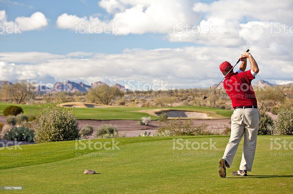 Male Caucasian Golfer on the Tee Desert Golf Course stock photo