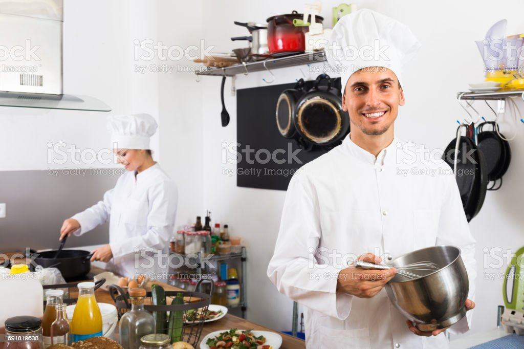 male chef at cafe's kitchen stock photo