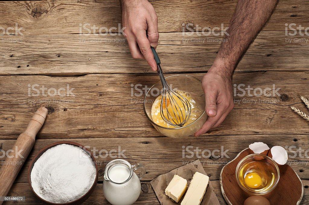 Male chef prepares on rustic kitchen stock photo