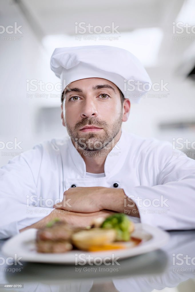 Male chef showing food stock photo