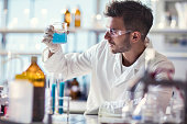 Male chemist working on chemical substances in a laboratory.