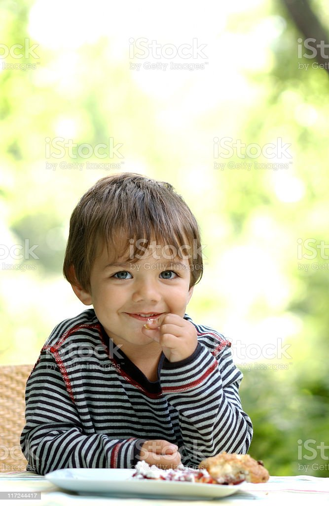 male child eating royalty-free stock photo