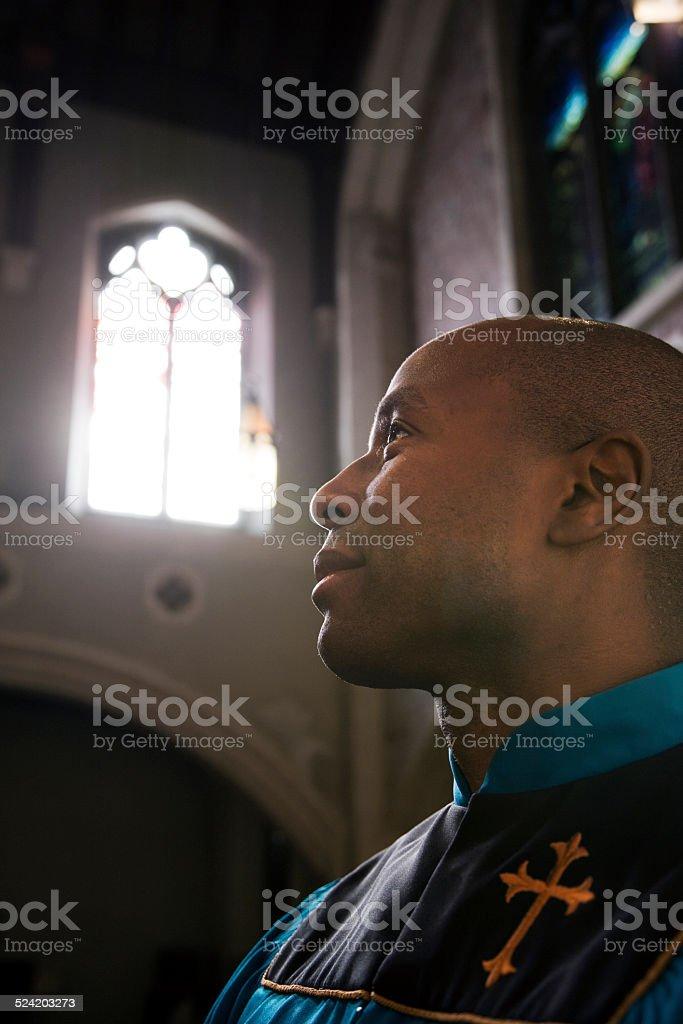 Male Church Member Praying During Service stock photo