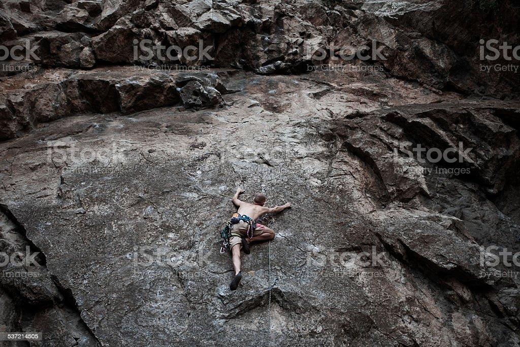 Male Climber Climbing outside stock photo