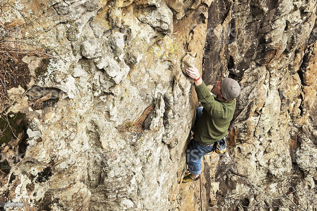 Male climber on rock face royalty-free stock photo