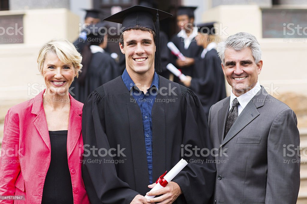 male college graduate and parents stock photo