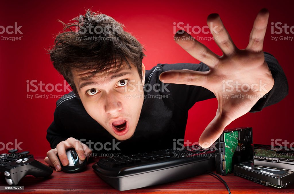 Male computer gamer reaching for screen with shocked face royalty-free stock photo