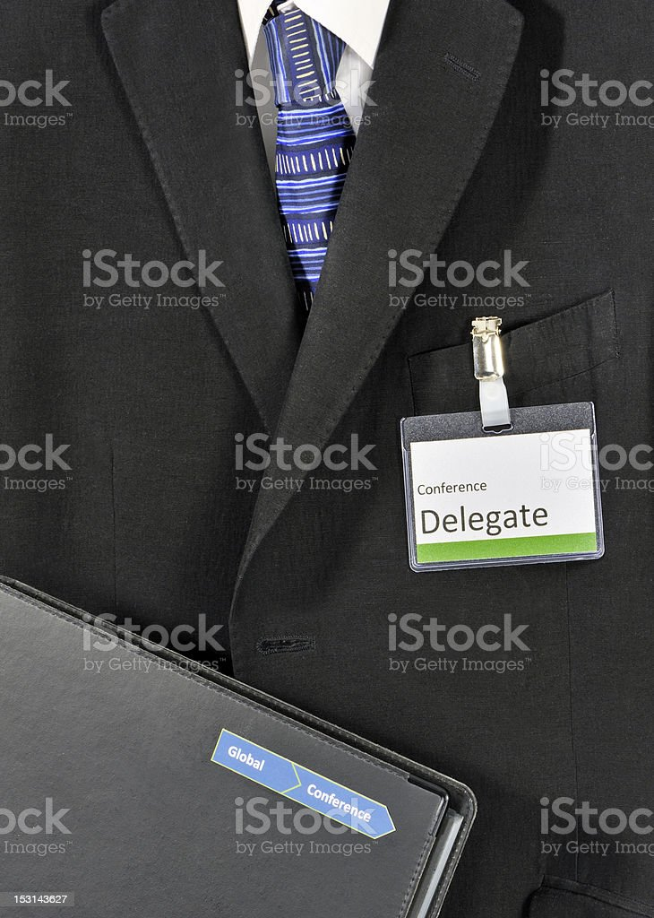 Male conference delegate in suit stock photo