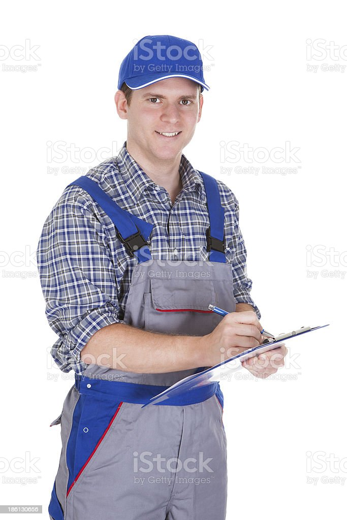 Male construction worker holding clipboard royalty-free stock photo
