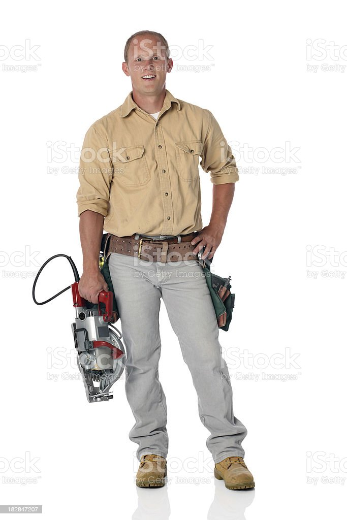 Male construction worker holding electric saw royalty-free stock photo