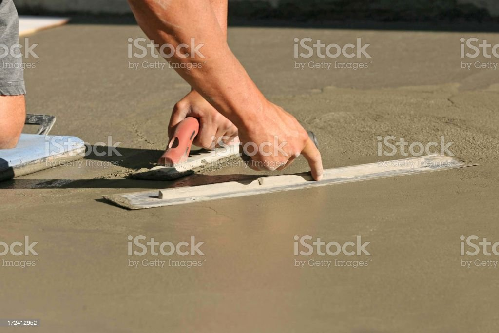 A male construction worker smoothing wet concrete royalty-free stock photo
