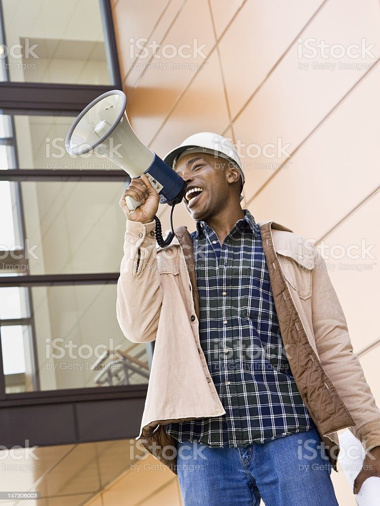 Male Construction Worker Using Bullhorn royalty-free stock photo