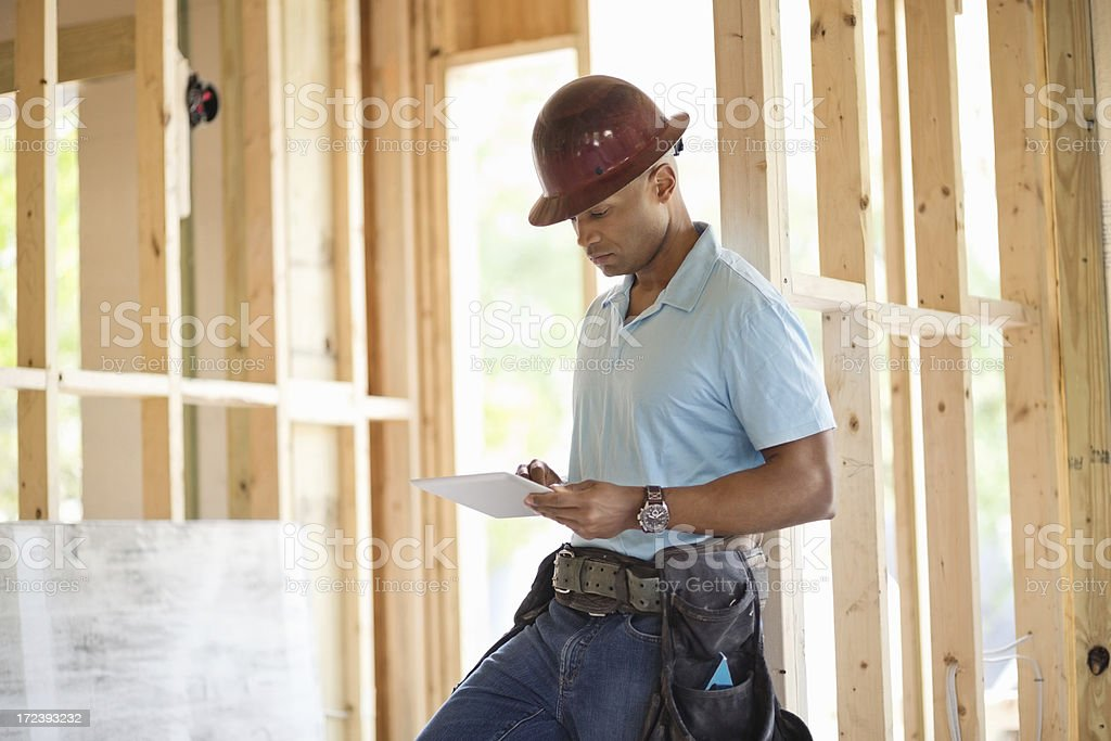 Male Construction Worker Using Digital Tablet royalty-free stock photo