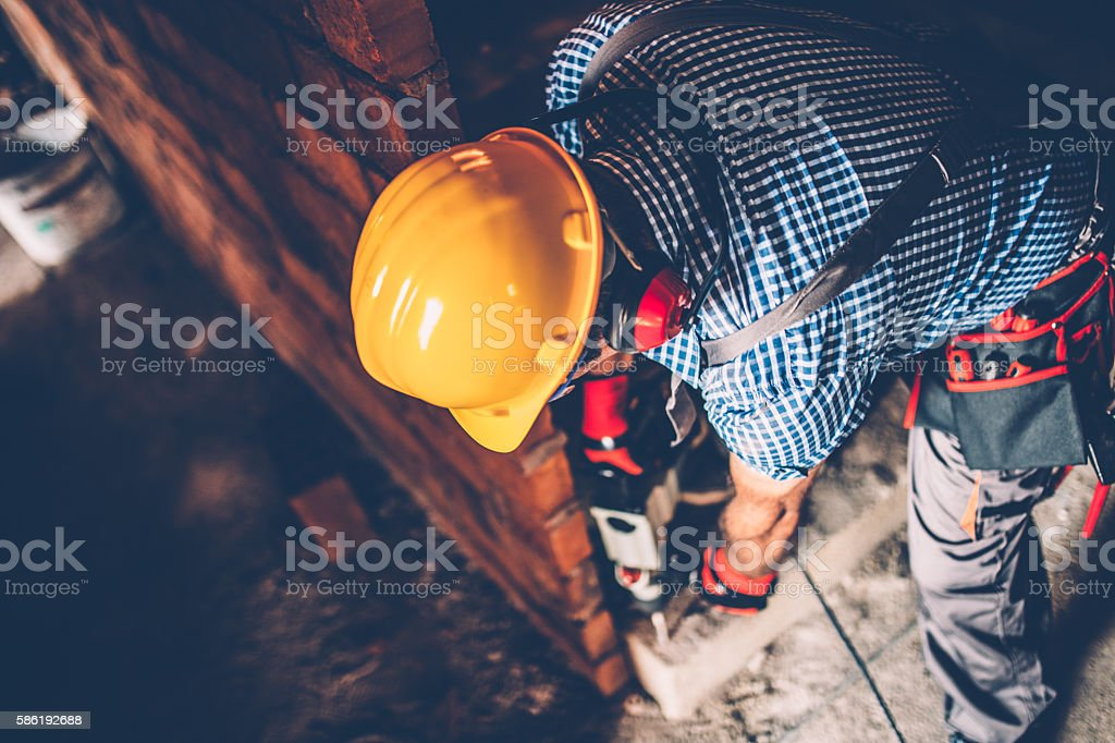 Male construction worker with a drill stock photo