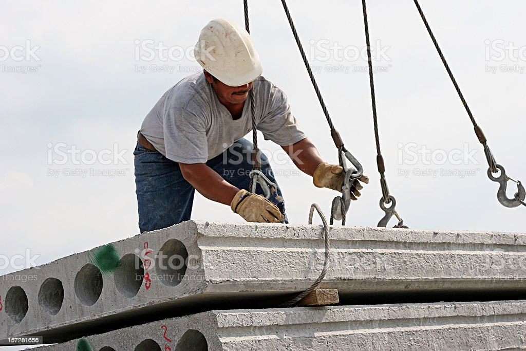A male construction worker working with winches stock photo