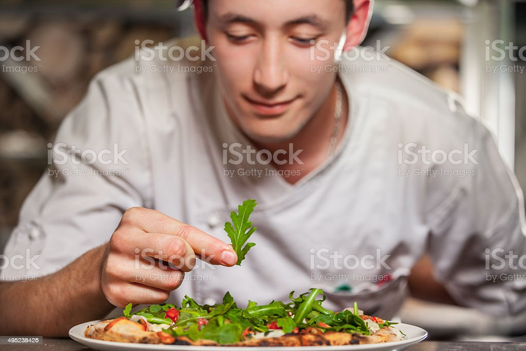 male cook preparing delicious appetizer stock photo
