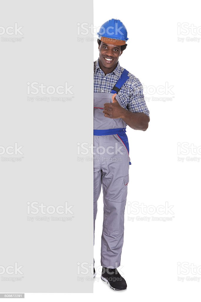 Male Craftsman With Blank Card royalty-free stock photo