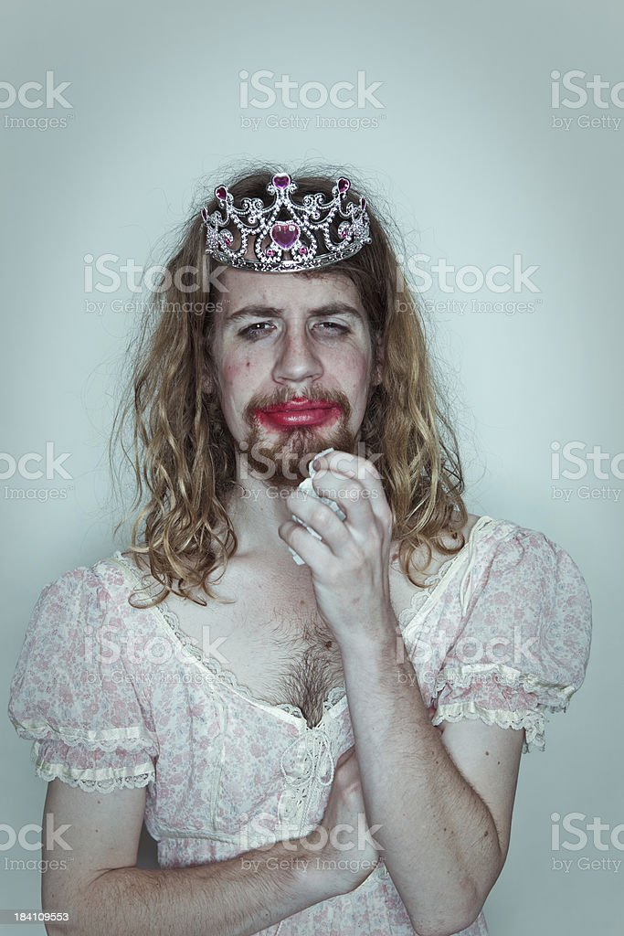 Male crying Prom queen tissue drag tiara on head lipstick stock photo