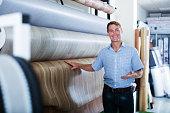 male customer choosing linoleum flooring