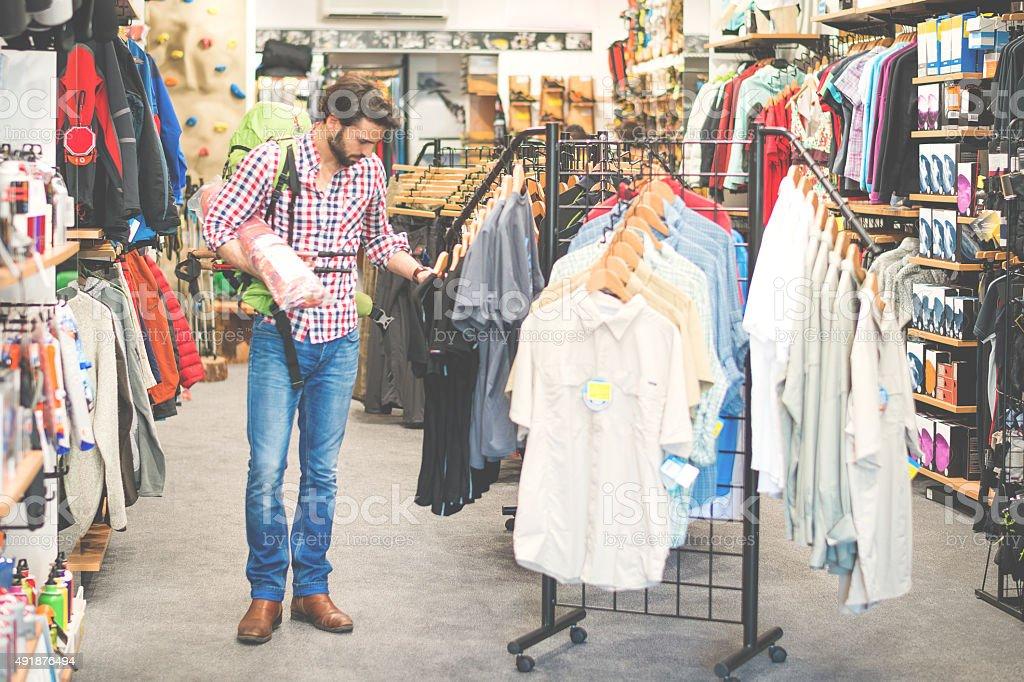 Male customer in outdoor equipment mega store stock photo