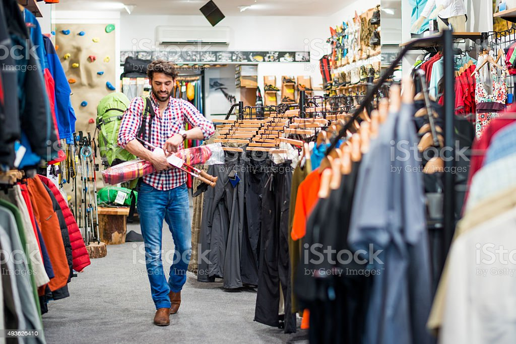 Male customer in outdoor equipment store stock photo